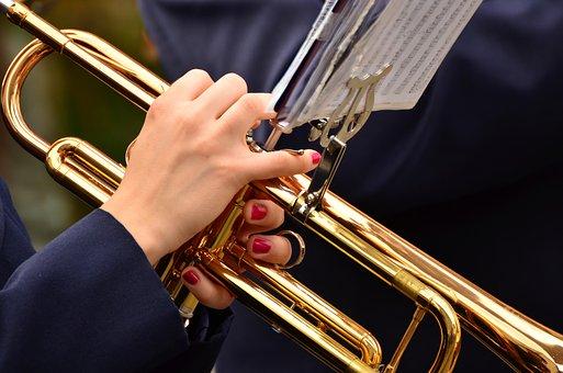 Women Holding a Trumpet