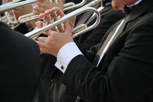 Left Hand Holding Trumpet