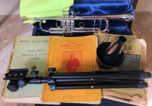 Trumpet Accessories. Vincent Bach trumpet, method books, mute, and stand