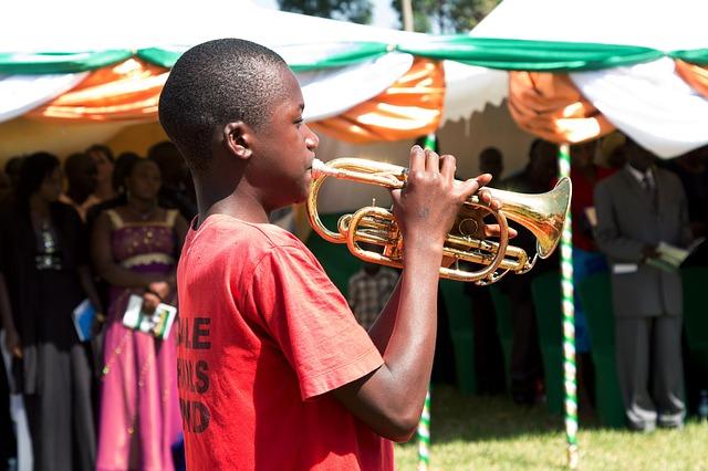 Young man playing a cornet